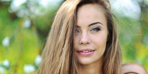 Beautiful girl face   closeup outdoor portrait